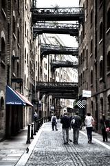 Shad Thames (Nigel Jones QGPP) Tags: street old people london coffee thames river pigeon bridges restaurants tourists warehouse lane expensive cobbles shadthames cafes modernapartments