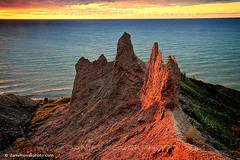 The Last Light at Chimney Bluffs (DTA_7544-75) (masinka) Tags: statepark park sunset sky sun lake snow ny newyork ontario west beach nature water rain iceage clouds forest spectacular landscape woods waves natural wind cloudy spires hike cliffs greatlakes glacier erosion trail clay centralnewyork rays sight lakeontario drama drumlin suspense expectation waterlevel chimneybluffs sodusbay sustainedwind