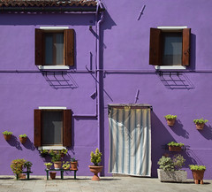 Happiness is.. (areyarey) Tags: door city travel flowers venice houses homes shadow summer urban italy sun sunlight house color colour building home window colors wall architecture facade happy italian colorful europe mediterranean italia european shadows village purple bright outdoor vibrant painted traditional decoration vivid peaceful sunny front architectural shutters attractive venetian flowerpot brightcolors colourful framing typical residential venecia venezia windowframe burano bold combination fasade veneto brightly entrancedoor exteriordesign areyarey