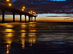 The Ripple Lines (Steve Taylor (Photography)) Tags: ocean sea newzealand christchurch sky orange cloud lines silhouette dawn lights coast pier sand waves canterbury southisland column ripples lamps lowtide daybreak newbrighton