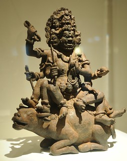 From http://www.flickr.com/photos/71401718@N00/10578893433/: Yamantaka, Fear-Striking Vajra, Lord of Death (Tibetan:  Gshin-rje-gshed), multiheaded, holding vajra, rope, dagger, riding a water buffalo, statue of a guardian, enormous strength, Tibetan Esoteric Buddhism, Art Institute, Chicago, Illinois, USA