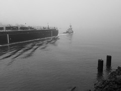 Amberjack (KaDeWeGirl) Tags: newyorkcity bw fog manhattan eastriver tugboat barge amberjack