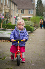 December 8th - riding her new bike (Iris de Ronde) Tags: smcm50mmf17 pentaxk5ii vision:people=099 vision:face=099 vision:text=0542 vision:outdoor=0939 singleindecember2013