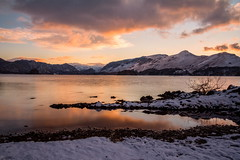 Derwent Water, Keswick (Jo Bowman) Tags: trees sunset sky lake snow mountains reflection water clouds canon evening rocks stones district derwent sigma1020mmlens 60d goldenart jobowman2014