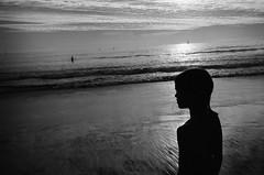 a girl @ santa monica beach (SungsooLee.com) Tags: california leica shadow sea people blackandwhite bw film beach girl silhouette 35mm blackwhite delta summicron 400 mp seashore ilford asph delta400 f20 mydays mydaysphoto