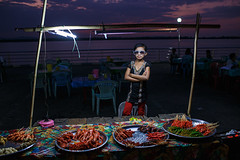 Barbecue - Mawlamyine, Myanmar (Maciej Dakowicz) Tags: street portrait people food sunglasses glasses burma bbq barbecue nightmarket myanmar seller mawlamyaing mawlamyine