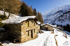 Case di Pirli (Andrea Moraschetti Photography) Tags: ngc nature snow pns national park stelvio italy italian landscape view building house tree woods white winter morning place brescia pontedilegno vallecamonica mountains sky blue