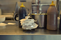 Paid (Kim Yokota) Tags: restaurant counter receipts sauces seasoning food booked toronto ontario canada nikond7000 nikonafsnikkor24mmf14ged