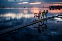 Front Row Seats - Waiting for Dawn (Don3rdSE) Tags: trip pink blue lake color reflection nature water june wisconsin sailboat sunrise canon landscape eos pier university chairs terrace madison 7d mast sailboats wi waterscape lakemendota moored 2013 wisconsinmemorialunion canon7d oltusfotos don3rdse 3rdsiblingphotography