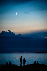 just a sliver in the sky (bluechameleon) Tags: ocean summer sky people moon water night vancouver clouds boats lights twilight silhouettes englishbay bluehour benches crescentmoon bluechameleon sharonwish bluechameleonphotography