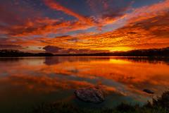 Earth, Water, Fire, Air (hawaiiansupaman) Tags: sky reflection nature water rock clouds sunrise canon hawaii day cloudy maui morningsky oneshot waterscape kahului kanahapond vision:sunset=097 kanahapondwildlifesanctuary