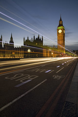 Two Double Deckers and a pulsating cyclist (Steve Dubois) Tags: longexposure london night housesofparliament bigben lighttrails cyclelane buslane