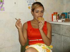 The Seductive Bite (STUDIOZ7) Tags: flowers woman girl misty cookie eating cigarette retro smoking apron smoker housewife homemaker terraflemming