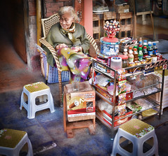 Absolutely charming Old Lady street trader in Hanoi's Old Quarter