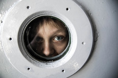 Now it's time to leave the capsule if you dare (rsvatox) Tags: kaliningrad portrait face travel kid musem eye boy worldoceanmuseum