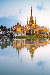 Beautiful Thai Temple (Wat Non Kum) and Reflection (baddoguy) Tags: architecture awe buddhism buildingexterior chineseculture colorimage copyspace dramaticsky elegance famousplace goldcolored igniting illuminated lake landscape lighteffect locallandmark majestic nakhonratchasima nopeople outdoors palmtree peaktower photography placeofworship pond publicpark reflection religion ruralscene scenics spiked spire standingwater sunset symmetry templebuilding thaiculture thailand tourism tranquility travel traveldestinations twilight vertical wat water watersurface