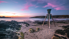 Pretty in Pink (Einir Wyn Leigh) Tags: sunset weather sky pink clouds sunlight ocean sea beach bell orange blue green sand coast island anglesey beauty landscape seascape passion love happiness wales cymru uk