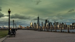 Sunset and NY skyscrapers (bhumin_desai_303) Tags: rokinon rokinon24mm urbanlandscape sunset dramaticclouds a6300 sonyalpha newjersey libertystatepark