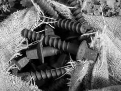 Bolts in a burlap sack (Franco & Lia) Tags: blackandwhite bw texture noiretblanc railway bn sw bolts sack biancoenero burlap blackdiamond ferrovia binari bulloni blackwhitephotos traversine flickraward mygearandme ringexcellence