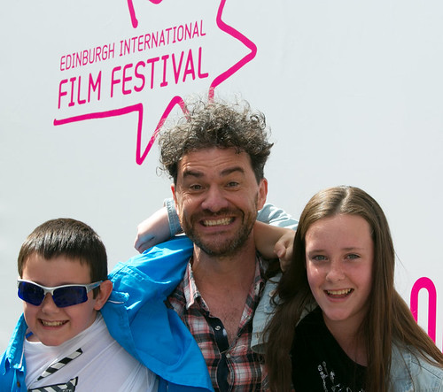 Mark Cousins with his niece and nephew outside Filmhouse before his film A Story of Children and Film