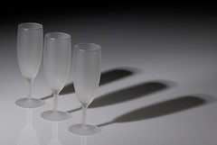 Champagne Flutes & Shadows (Geoff France) Tags: glass monochrome mono wine drink champagne moetchandon penumbra bollinger umbra
