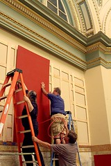 Bill Parret, Barnaby Evans, and Gary LeFrancois installing wall panels in the bank.