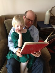 Molly Reading A Book With Her Dad (Lynn Friedman) Tags: family home girl youth reading book education dad father stock daughter molly read learning teaching gettyimages literacy quietmoment lynnfriedman
