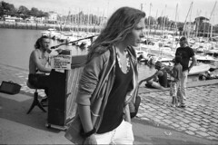 PIANO (Zixbook.com) Tags: life street travel sea vacation bw music white holiday money black france tourism girl hat harbor boat photo seaside harbour candid hard piano documentary pedestrian tourist walker singer microphone larochelle