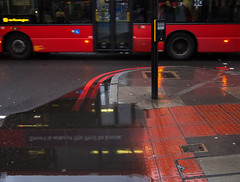 hanging around on street corners (donvucl) Tags: red urban bus london rain reflections puddle eustonrd donvucl olympusepl520mm