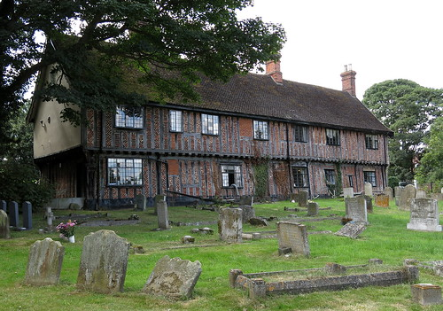 The former guildhall (c. 1509, altered 1616), now the Fox and Goose Restaurant, at the edge of the churchyard of St Peter and St Paul, Fressingfield, Suffolk, England