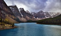 Valley of the Ten Peaks and Moraine Lake (Banff National Park) (thor_mark ) Tags: nikond800e day4 triptoalbertaandbritishcolumbia banffnationalpark overcast valleyofthetenpeaks morainerockpiletrail morainelake lake lookingssw capturenx2edited colorefexpro outside nature landscape mostlycloudy cloudsaroundmountains lowclouds rockymountains canadianrockies mountains mountainsindistance mountainsoffindistance mountainside trees evergreens hillsideoftrees glacialflour glaciallake glacialvalley morainelakearea valley snowcapped mountainvalley continentaldivide lookingtocontinentaldivide lookingtomountainsofthecontinentaldivide southerncontinentalranges banfflakelouisecorearea bowrange mountbabel mountlittle mountbowlen mounttonsa mountperren mountallen mounttuzo project365 portfolio canvas alberta canada