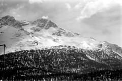 04a3371 26 (ndpa / s. lundeen, archivist) Tags: nick dewolf nickdewolf bw blackwhite photographbynickdewolf film monochrome blackandwhite april 1971 1970s 35mm europe centraleurope switzerland swiss alpine alps graubünden grisons stmoritz easternswitzerland suisse schweitz mountains peaks snow snowy snowcovered skiresort skiarea skislopes landscape sky clouds trees swissalps