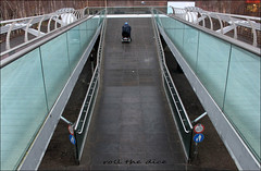 `1915 (roll the dice) Tags: london se1 southwark man early millenniumbridge steel surreal speed wheelchair electric freedom mad sad funny sivk urban england uk classic art canon tourism tate gallery streetphotography people natural wisdom danger unaware unknown ramp fashion shopping fit powered mobility portrait stranger candid river thames view up empty londonist blackfriars old