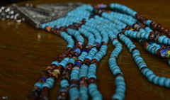 waves of colors (Doctor Ahmed Badr) Tags: blue beads necklace art macro closeup brown jewelry jewels nikond3200 minimalism wood turquoise accessory