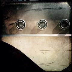Branded (Maureen Bond) Tags: light sunlight car piece three junkyard desert abandoned classic ca maureenbond dented scratched round circles trim buick portholes