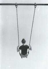 Swing high (Emma Vaincourt) Tags: sky blackandwhite film girl swing scratch bun