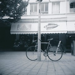 Bicycle and Landspeed (sonofwalrus) Tags: blackandwhite bw records film bicycle holga lomo lomography scan recordstore landspeedrecords hpc5380
