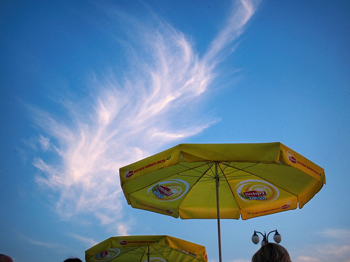 blue sky yellow umbrellas