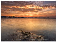 Golden dusk at Les Deveses (Javier Girbs) Tags: sunset sky seascape sol beach water canon reflections atardecer mar twilight agua rocks colours playa colores cielo nubes reverse filters 11mm oliva hitech roca mediterrneo reflejos denia lateafternoon filtros comunidadvalenciana strangesky 600d riprap paisajemarino tokinaatxpro ultrawideanglelens twostops ultraangular tokina1116 leefoundationkit silkywatereffect lesdeveses rgnd06 javiergirbs