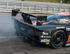 Burn out leaving the pit box (NikonJim) Tags: park pit racing prototype lane dp daytona corvette limerock grandam d300 nikonjim