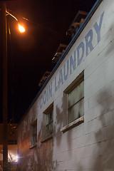 Creepy-Ass Coin Op (El Shooterino) Tags: street light window lamp wall night dark 50mm prime coin alley closed f14 creepy idaho boise laundry block op dim laundromat cinderblock maytag cinder
