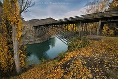 Bridge over colored water (PhotoArt Images) Tags: bridge fall poplartrees nzsouthisland nikon1424f28 autumninnz gibbstonhwy photoartimages glacielwater