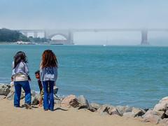 w/o (kaihm) Tags: california street bridge sea usa beach fog hair golden kid sand gate san francisco fuji candid foggy cal fujifilm sanfran behind frisco kalifornien x10 ggb