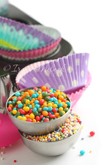 Candy sprinkles with cupcake cases and baking pan (Iryna Melnyk) Tags: pink blue red food white green tower utensils cooking cup kitchen colors yellow cake metal closeup paper dessert baking mix colorful purple candy bright pastel background empty group objects nobody case stack equipment cupcake sprinkles pastry pan form colourful copyspace muffin bake isolated preparation wrapper holders containers preparing liner bakeware