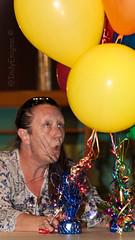 Kiffy vs. balloons... (IndyEnigma) Tags: orange woman yellow dof bokeh flash balloon kathy wife bouquet kiffy d80