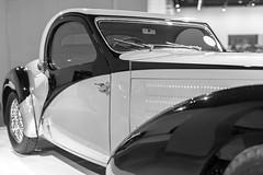 Bugatti Style (Thad Zajdowicz) Tags: zajdowicz losangeles california petersenautomotivemuseum availablelight indoor inside museum canon eos 5dmarkiii 5d3 dslr digital lightroom ef50mmf12lusm 50mm primelens car bugatti classic vintage automobile artdeco blackandwhite black white bw monochrome door fender windshield
