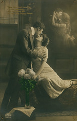 Passionate Edwardians (Tyne & Wear Archives & Museums) Tags: postcard edwardian kissing passion passionate embrace flowers tenderness sensual racy tender digitalimage blackandwhitephotograph holes mark blur tear colour earlytwentiethcentury socialhistory handwriting text transcription romantic emotional poignant interesting unusual fascinating insight portrait archives postcards inscription love vase carpet floor interior room wall frame window glass curtain furnishings box cloth bed necklace dress suit shirt immaculate pocket plate grain cabinet light dark crease puncture northeastofengland unitedkingdom man woman tie ribbon hair