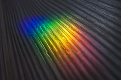 Refraction (petrapetruta) Tags: rainbow colors floor closeup throughherlens light