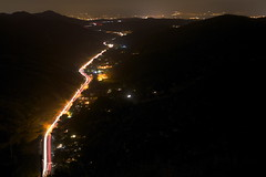 Laguna Canyon (rileymauk) Tags: california longexposure nightphotography travel sky foothills mountains art nature cali night composition canon landscape outdoors photography rebel lights highway scenery view hiking trails lookout canyon hike hills trail socal citylights slowshutter nightsky lighttrails wilderness orangecounty dslr carlights lagunabeach xsi canyonroad cartrails lagunacanyon 450d