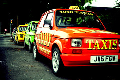 Taxi? (Anthony Bean) Tags: auto park uk greatbritain red england baby black green glass car wheel yellow closeup standing manchester toy grey miniature automobile waiting order cab taxi small transport gray plate mini file row que taxis line advertisement clean chain collection queue transportation advert wait series rest daytime parked motor passenger q rank salford reserved cramped collect registration compact leyland 1010 orderly linedup gather wingmirror succession booked sorn anthonybean
